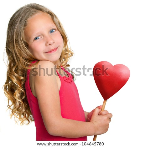 Close up Portrait of cute little girl holding red heart.Isolated on white background.