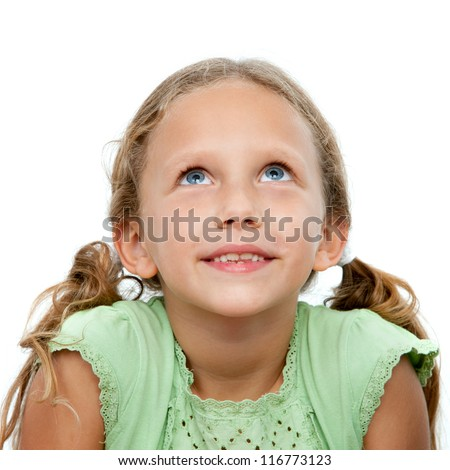 Close up portrait of cute little girl looking up.Isolated on white background.