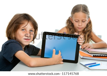 Close up portrait of cute maths student pointing at numbers on digital tablet.
