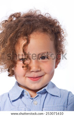 Close up Portrait of Cute Smiling Kid with Curly Hair Looking at the Camera. Isolated on White Background - stock photo