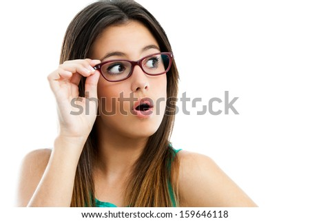 Close up portrait of cute teen girl wearing glasses looking aside.Isolated on white. - stock photo