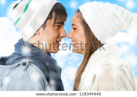 Close up portrait of cute young couple outdoors in snow. - stock photo