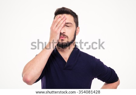 Close up portrait of disappointed stressed bearded young man in sweetshirt with closed eyes over white background - stock photo