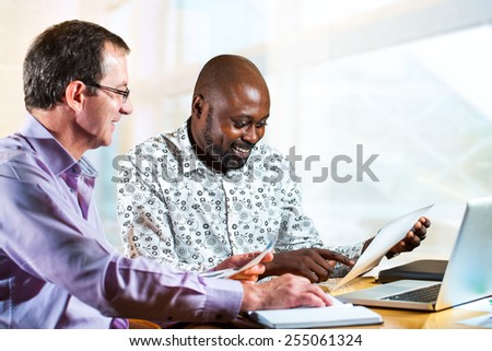 Close up portrait of diverse business partners working together on project. - stock photo