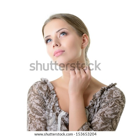 Close-up portrait of dreaming and planing girl looking up into the corner, isolated on white background with copyspace - stock photo