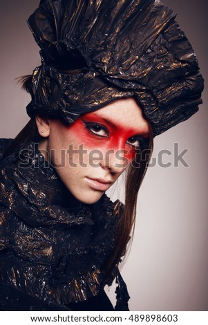 Close up Portrait of elegance woman with red make up with metal head wear