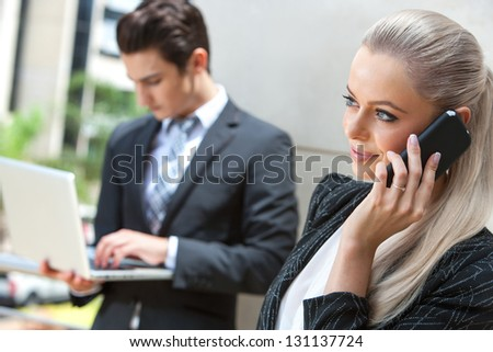 Close up portrait of elegant businesswoman talking on smart phone at outdoor meeting. - stock photo