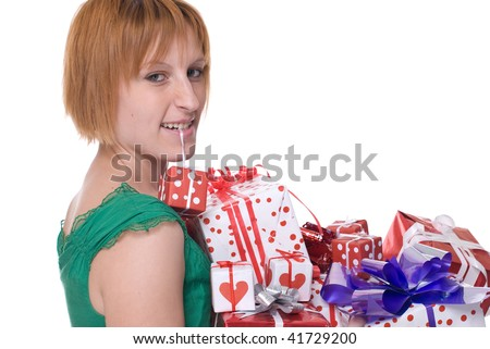 Close up portrait of emotional girl in green dress with some gifts in mouth - stock photo