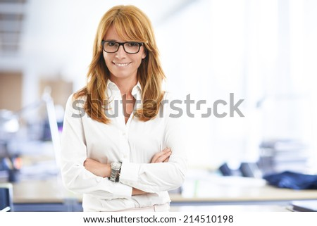 Close-up portrait of executive business woman standing at office. Business people.  - stock photo