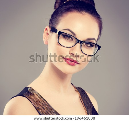 Close-up portrait of fashion glamour model wearing spectacles. Young attractive Caucasian  woman posing in studio looking at camera.  - stock photo