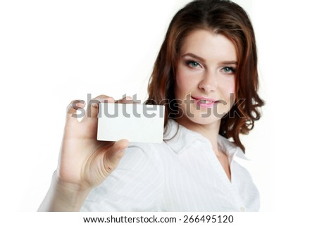 Close-up portrait of female holding credit card, shallow depth of field, focus on the credit card, over white background - stock photo