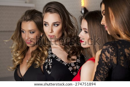 Close up portrait of four beautiful glamorous young women in studio - stock photo