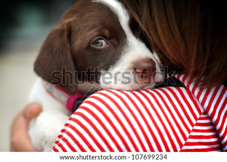 close up portrait of girl hugging dog - stock photo