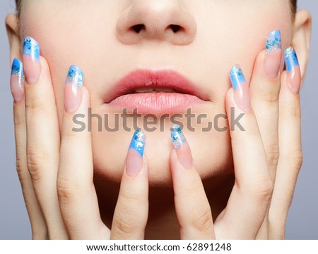 close-up portrait of girl's lower part of face and manicured fingers