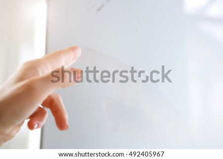 Close up portrait of hand pointing to blank screen