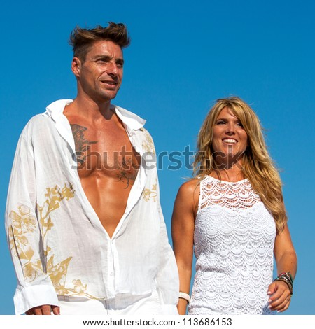 Close up portrait of handsome couple in white outdoors.