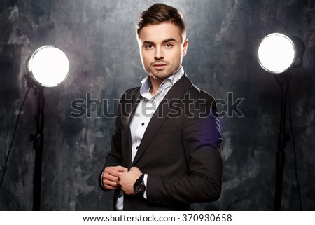 Close-up portrait of handsome elegant young man in a suit - stock photo