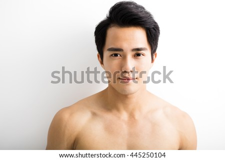 Close up portrait of  handsome young man - stock photo