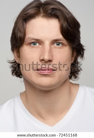 Close-up portrait of  handsome young man looking at camera - stock photo