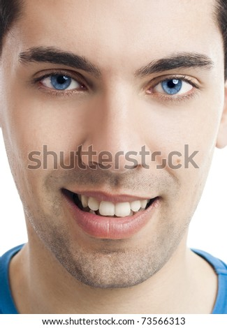 Close-up portrait of handsome young man with blue eyes - stock photo