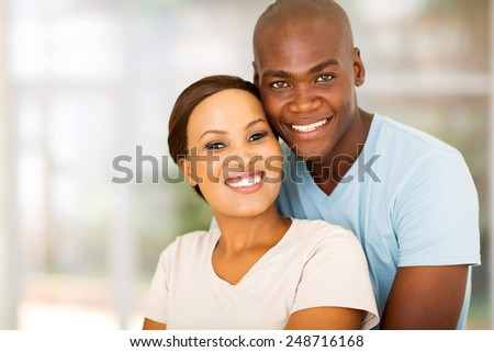 close up portrait of happy african couple at home - stock photo