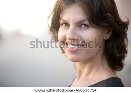 Close up portrait of happy beautiful business woman posing on the street in summer, friendly smiling, looking at camera with cheerful confident expression - stock photo