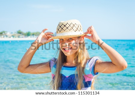 Close up portrait of happy beautiful girl in the beach hat relax near the sea - stock photo