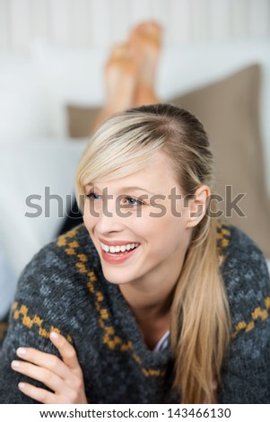 Close up portrait of happy blond woman looking at something - stock photo