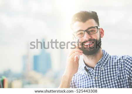 Close up portrait of happy caucasian male talking on cellphone