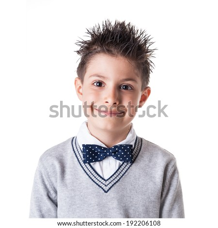 Close up portrait of happy eight year kid wearing papillon against white background.  - stock photo