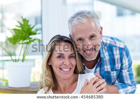 Close-up portrait of happy mature couple in restaurant - stock photo