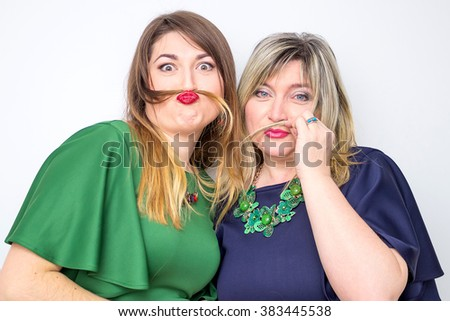 close up portrait of happy mother and daughter. happy mother and young daughter wearing in elegant dress making funny