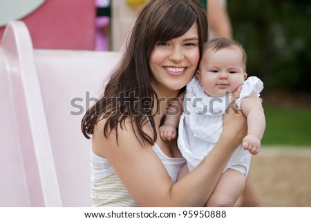 Close-up portrait of happy mother with her adorable daughter - stock photo