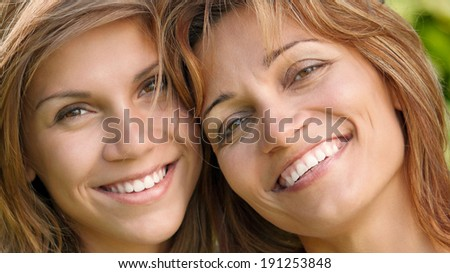 Close-up portrait of happy mother with her daughter - stock photo