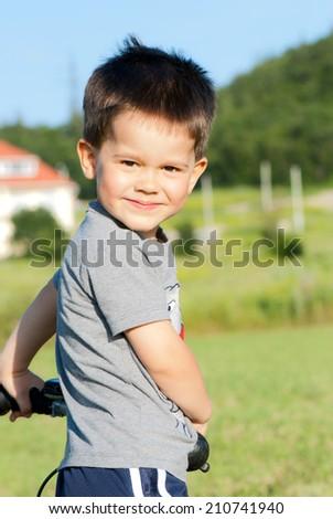 Close up portrait of happy smiling little boy - stock photo