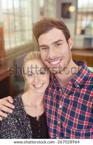 Close up Portrait of Happy Sweet Young White Couple Looking at the Camera with a Toothy Smile. - stock photo