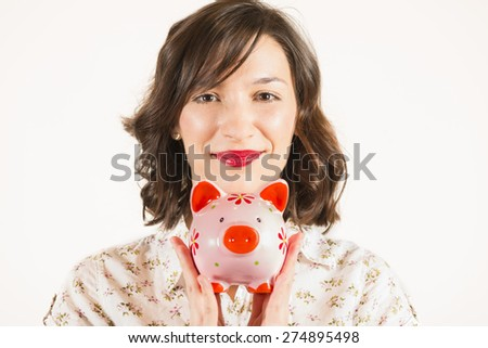 Close up portrait of happy young beautiful woman with pink piggy bank, studio shot on white background - stock photo