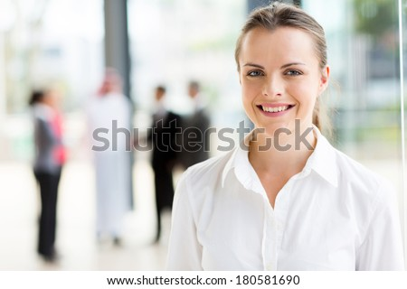 close up portrait of happy young businesswoman - stock photo