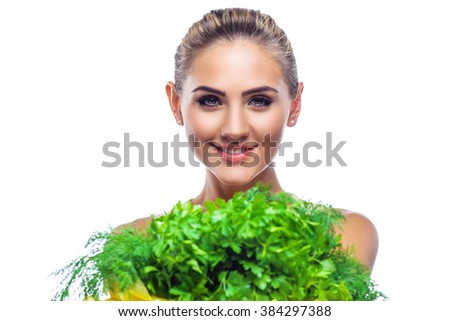 Close-up portrait of happy young woman with a bundle of fresh herbs. Concept vegetarian dieting - healthy food - stock photo