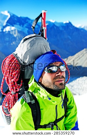 close up portrait of hiker looking at the summit - stock photo