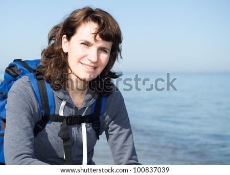 Close-Up portrait of hiking relaxing woman at sea