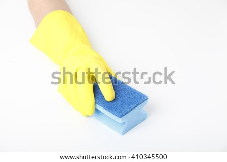 Close-up portrait of housekeeper hand with rubber glove holding sponge and cleaning surface. Isolated on white background.