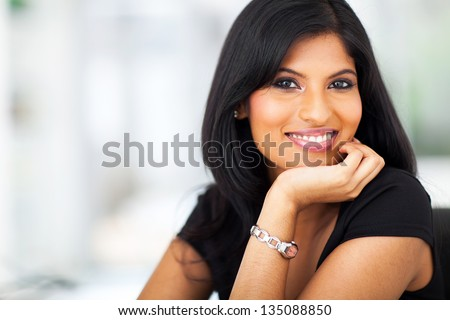 close up portrait of indian smiling businesswoman in office - stock photo