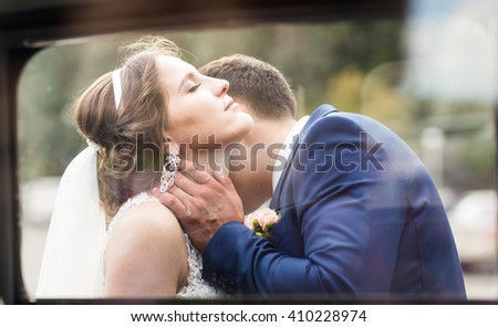 Close up portrait of kissing wedding couple