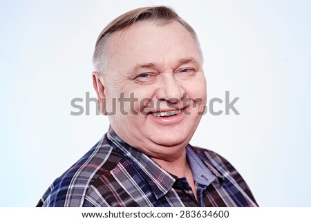 Close up portrait of laughing aged man in plaid shirt over white background - stock photo