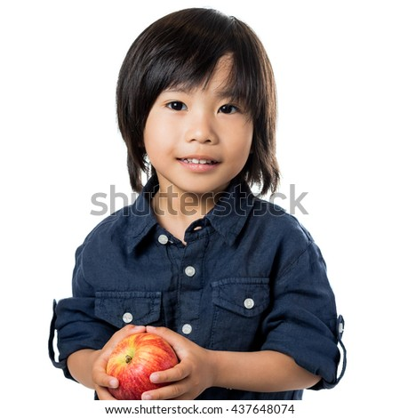 Close up portrait of little asian boy holding red apple.Isolated on white background.