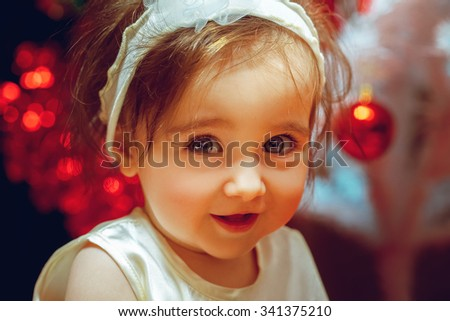 Close up portrait of little baby girl at christmas time. Christmas mood. New year. - stock photo