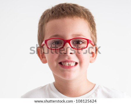 Close-up portrait of  little boy isolated with red eyeglasses on white background