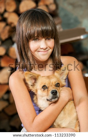 Close up portrait of little girl and her dog. - stock photo