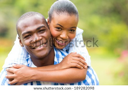 close up portrait of loving african couple